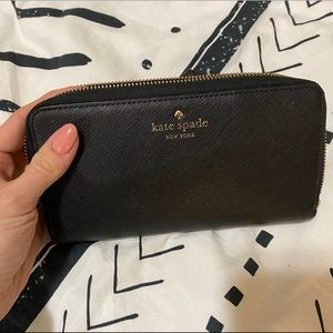 Kate Spade wallet with stripes interior
